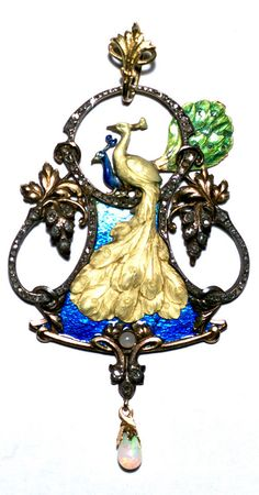 An Art Nouveau yellow and white gold, silver foil, enamel, diamond and fire opal Peacock pendant, French, circa 1900. 8.5 x 4.6 cm. Stamped with an Eagle's head. #ArtNouveau #pendant