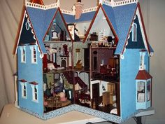 I spared no expenses when making the large Victorian Dollhouse. It is 44 inches long. 31 inches wide and stands over 38 inches tall. The dollhouse features nine rooms as well as a turret room. The windows can open and close and the dollhouse has two movable bay windows that reveal the