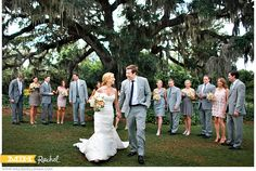 bride groom walk while bridal party behind     Millie Holloman Photography