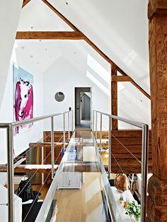 Vigas de Madera, decoración rústica y acogedora en un espacio loft