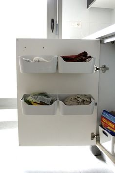 The measurements on these look a little big, (Variera boxes from Ikea, $5.99) but maybe something like this in the bathroom cupboards for washclothes and things??