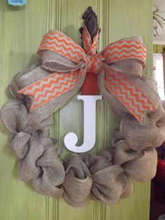 Ruffles of burlap, chevron ribbon and a monogram makes for a simple yet elegant wreath to hang above the mantle for a rehearsal dinner decoration turned wedding gift for the bride and groom-to-be.  The soon to be mother-in-law LOVED it and we are sure that her almost daughter-in-law will be thrilled to hang that the day after the wedding! Find more of my work at facebook.com/forgetmenotskershaw