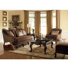 Old world opulence fit for a king - or queen! Luxurious fabrics in spice and deep soft browns trimmed in deeply carved wood trim. Living Room Art, Living Room Furniture, Furniture Sets, Art Van, Chocolate Couch, Michigan, Brown Trim, Wood Trim, Old World Charm