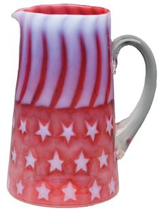 Hobbs, Brockunier & Co. Stars and Stripes water pitcher in cranberry opalescent glass