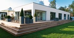 Love the clean lines and the wooden deck.