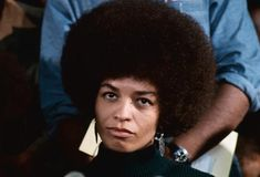 Angela Davis a black feminist was arrested in1972. This photograph was taken at a press conference following her arrest.