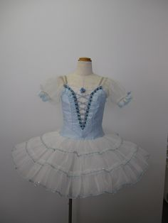 """This delightful ballet costume has been created fort he role of Swanilda in the ballet """"Coppelia"""". It can also be used for other ballets like """"The Fairy Doll"""", and many other. The bodice is created is"""
