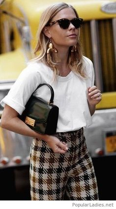 White blouse, plaid pants and black bag