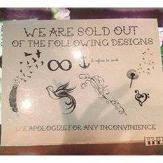 Sign at a tattoo shop...funny!  They are probably tired of the trendy tattoos.