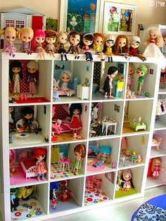 A dollhouse in a bookcase