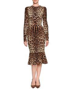 Dolce & Gabbana Long Sleeve Leopard Print Midi Dress. $2,995.00     Round neckline.     Long sleeves.     Seam at natural waist.     Fitted silhouette.     Ruffled flounce hem.     Hidden back zip.     Silk/spandex.     Made in Italy.