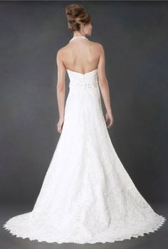 Nicole Alyne Bridal by RIVINI Wedding Gown. Backview.