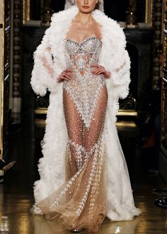 Reminds me of some of the Bob Mackie gowns that Cher used to wear...