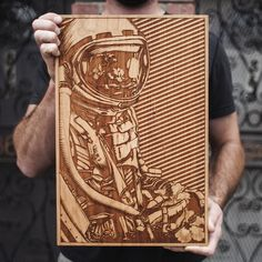 "No matter how far we advance as individuals or as a civilization we will inevitably cycle back to the ether and provide our atoms for a new form.This beautiful limited edition ""Rebirth"" wooden poster has been laser engraved on US sourced cherry hardwood.  Each one is carefully cut, sanded, and oiled by hand then put under a powerful laser in order to burn in this SpaceWolf original design.Only 50 of these will ever be created.11.5in x 17.5in x .75inPlease a..."