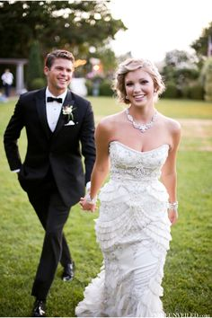 The details on this dress are incredible. Fitted through the hips, the ruffles are like petals, and the pleated tulle is just the best---not to mention the beading and built in contouring. Gatsby Wedding Inspiration