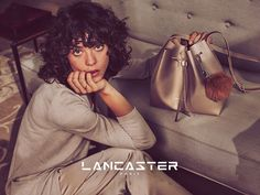 Lancaster FW16 campaign with Steffy Argelich, shooting by Guy Aroch. (Champagne bucket bag Pur Saffiano, available on www.lancaster.com) #fw16 #fashion #campaign #bag #steffyargelich #guyaroch #lancasterparis #lancaster #champagne #gold #blingbling #shiny #bucketbag #bag #pur #fashion #style #accessory #sofa #couch #livingroom #cosy