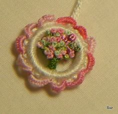 This little Dorset Button has lots of french knots; size of quarter