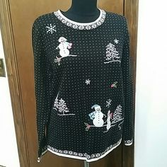 Black and White Christmas Sweater NWOT Ramie/cotton blend sweater. Never worn.  Reasonable offers welcome through the offer button. Bundle 2 or more items and save! Alfred Dunner Sweaters Crew & Scoop Necks