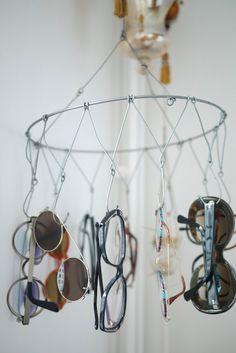 A veggie/fruit hanger used to display sunglasses / #storage #diy