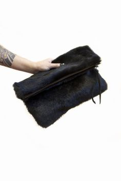 38660f2d23e The Primecut Foldover Clutch is the perfect size for a day in the city or a  night out. Dimensions  Measures x unfolded Details  Spanish goat hair  exterior, ...