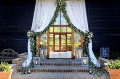 Beautiful decor to the ceremony barn doors at Upwaltham by Rose Cottage Flowers