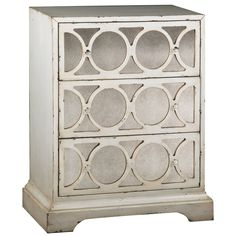 Inject stylish functionality into your home with this decorative mirrored accent chest. With an antiqued cream finish and three roomy drawers, this attractive piece updates the look of your room while providing you with much-needed storage.