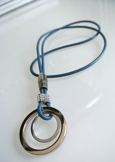 Hey, I found this really awesome Etsy listing at http://www.etsy.com/listing/115332220/necklace-lanyard-keychain-leather-round