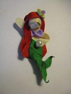 Hey, I found this really awesome Etsy listing at http://www.etsy.com/listing/79221196/ariel-inspired-hair-clip