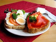 "Smorbrod; literally ""buttered bread,"" open-faced sandwiches popular in Scandinavia."