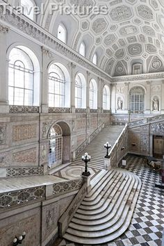 The main stairs and entrance way of the Royal Palace of Naples, Naples, Italy. The architecture is Italian Baroque, Neo-Classical.