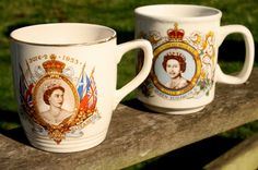 Royal mugs commemorating the Queen's coronation and Silver Jubilee.