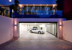 An exterior garage sliding door is a beneficial feature. The running tracks that hold and control the motion of the garage sliding door make the closed door very secure. Garage House, Dream Garage, Car Garage, Garage Parking, Small Garage, Garage Plans, Garage Ideas, Mansion Homes, Dream Mansion