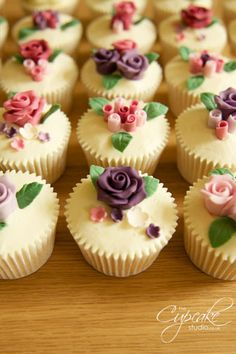 Such gorgeously elegant, wonderfully girly hued rose topped cupcakes. #roses #pink #purple #flowers #cupcakes #cake #wedding #food #dessert #baking #beautiful