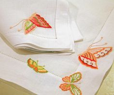 Placemat and napkin. D.Porthault Le Papillon embroidery