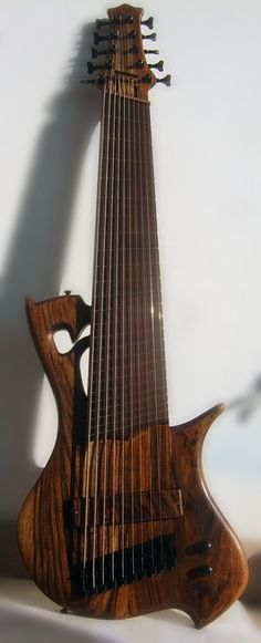 Prometeus 10 string bass - often found on Pinterest spelled with an H, as Prometheus. The company name has no H, sells both 8 and 10 string basses for 1800 Euro or $2,450 dollars range. - cSw - http://www.pinterest.com/claxtonw/4-5-6-strings/ - Technically this doesn't belong on my 4-5-6-Strings board, but hey wouldn't find lots of pins for an 8 10 12 strings board! Your choice for custom guitar FRETS: 21 - 36 (Add €100 for more than 24)