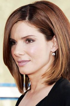 "To get smooth, sleek hair like Sandra Bullock, first apply a serum or cream to your hair and comb through. Part your hair on the side (diagonally, not straight back), and dry with a Mason Pearson brush. ""Then, flat-iron if needed for the finishing touch,"" recommends Vanessa Ungaro, stylist at Warren-Tricomi Salons."