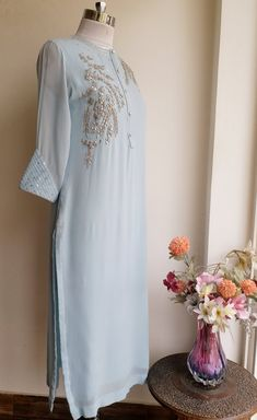 Featuring this Powder Blue Gota Patti kurti with fine traditional Gota Patti handwork on the front. The sleeves are with pintucks and sequins detailing. Kurta is straight fit with side slits. Fabric: Viscose Georgette Lining: Shantun Embroidery On Kurtis, Kurti Embroidery Design, Pakistani Dress Design, Pakistani Dresses, Frocks And Gowns, Kurti Patterns, Indian Designer Suits, Kurta Designs Women, Kurti Designs Party Wear