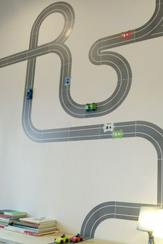 if I had a boy would totally do this in his room. Its stick decals so you can move the cars