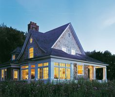 2,300 square-foot shingle style house with porches, terraces and over-sized bowed columns that together create a large, bold exterior presence. By Austin Patterson Disston Architects