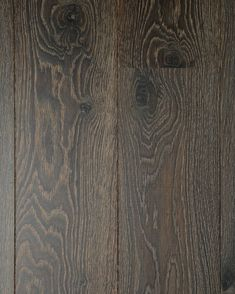 The boards in our Landmark collection are planed rather than sanded, which 'tears' the grain open, really celebrating the natural pattern of the timber. Applications of pigmented oils enhace the beauty of the grain further, as seen in this dark colour Ashridge.