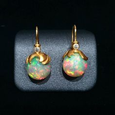 Lilly Fitzgerald Exceptional Hand-Carved Ethiopian Opal White Diamond Earrings   From a unique collection of vintage drop earrings at https://www.1stdibs.com/jewelry/earrings/drop-earrings/