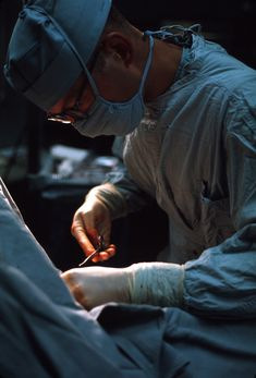 A US Army doctor performs surgery, 7th Surgical Hospital, 1968.