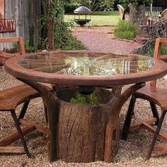 beautiful table made from wagon wheels