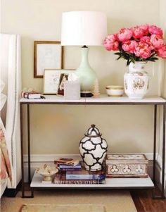 gold frame, pink peonies, black and white vase, and light teal lamp base