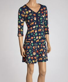 This frock flatters with a form-fitting design and low-set pockets. A charming print easily transitions from one season to the next, while a hint of stretch lends all-day comfort.
