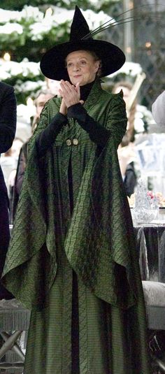 Minerva McGonagall wore a set of dress robes to the Yule Ball, which was held on Christmas Day, 1994, together with a hat on which she arranged a rather ugly wreath of thistles. The robes were made of a red tartan fabric. Her dress robes reflect Professor McGonagall's Scottish heritage, hailing from Caithness herself.