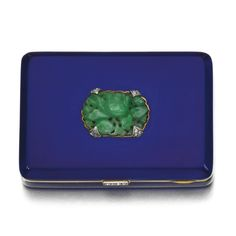 Jadeite, enamel and diamond vanity case, Chaumet, 1930 The rectangular case applied with blue enamel, decorated with a carved jadeite floral motif, accented with single-cut and rose diamonds, case measuring approximately 55 x 40 x 12mm, signed Chaumet, inscribed 24 Août 1930, gross weight approximately 104 grams.