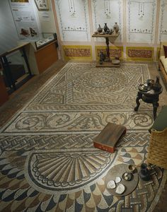 Back to Roman (AD 43 - AD 450)             Title:  The Bucklersbury Pavement; 250    Description:  A tesselated Roman pavement discovered in Bucklersbury in 1869. The mosaic has survived almost intact and measures some 6 by 3.6 metres.