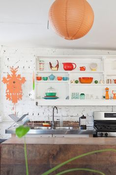 bright happy kitchen with orange accents  Design*Sponge Sneak Peeks