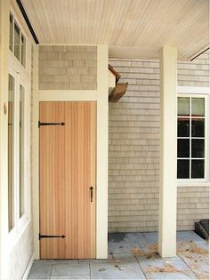 We need a door like this under our stoop. (Not necessarily with strap hinges.)